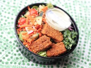 "Nourish's ""Salad of the Week"" - Local lettuce/kale/purple cabbage mix with veggie/quinoa mix, Ravishing (Vegan) Ranch dressing, and Almond Encrusted Tempeh w/ Cajun Spices.  (Photo Credit:  Nourish)"