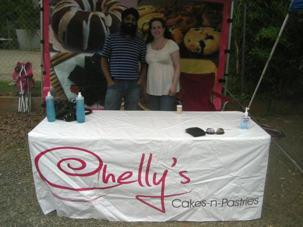 Amrik and I, (the organizers of VegCharlotte) helping out at the booth for Chelly's Cakes N Pastries.