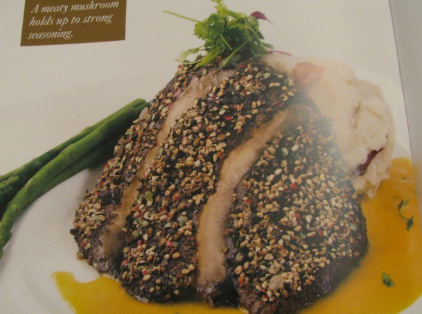 """Peppercorn-encrusted Portobello fillets with yellow tomato béarnaise and mashed potatoes.""  On my to-try list!"
