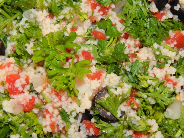 Couscous with olives and tomatoes close up