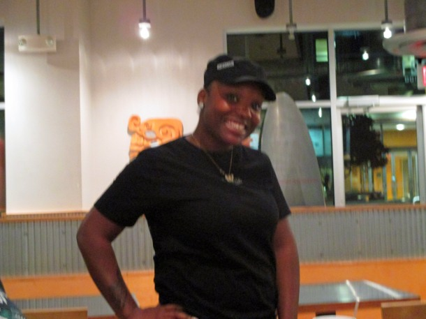 Smiling Chipotle worker